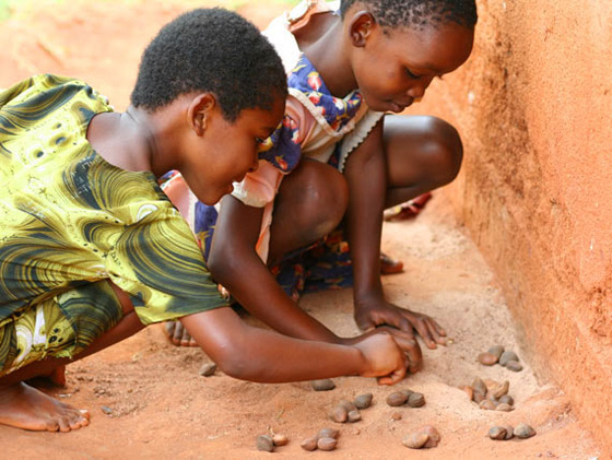 AIDS orphans in Africa playing game