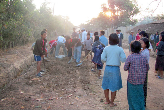 orphans in myanmar repair road