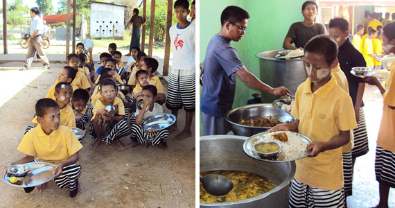 Boy inmates receiving food